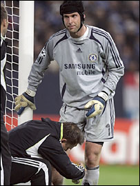 Petr Cech receives treatment for a calf strain
