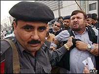A Pakistani protester is arrested