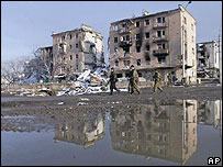 Russian troops patrol Minutka square in the Chechen capital Grozny, February 2000