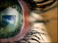 Facebook reflection in human eye, Getty