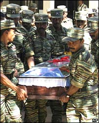 Tamil Tiger fighters carry coffin of political wing leader SP Thamilselvan, 5 November 2007