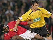 Darren Tinson (right) battles with Manchester United's Louis Saha in 2006