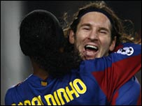 Ronaldhino congratulates Lionel Messi after the second goal