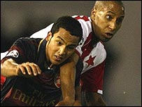 Arsenal's Theo Walcott (left) tussles with Slavia Prague's Mickael Tavares