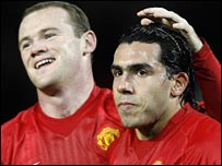 Wayne Rooney congratulates Carlos Tevez after Man Utd's second goal