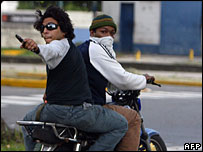 A gunman on a motorbike during clashes in Caracas, 7 November 2007