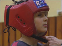 A boy training to be a Chess Boxer