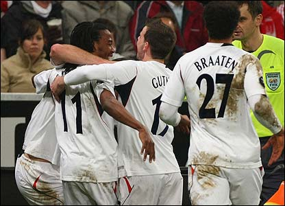 Bolton's Ricardo Gardner is mobbed by his team-mates
