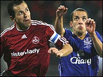 Everton's Leon Osman (right) vies for possession with Tomas Galasek