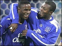 Victor Anichebe (left) is congratulated by Yakubu in Germany