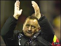 Jimmy Calderwood applauds the Aberdeen fans