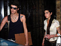 Singer Amy Winehouse and her husband Blake Fielder-Civil leave their home in Camden, London in August