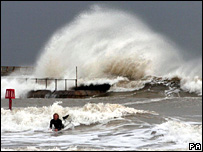 A surfer braves the waves at Goreleston-on-Sea, UK