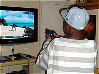 A boy playing with a gun in a computer game