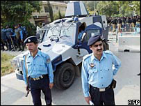 Pakistani police stand guard outside the residence of Benazir Bhutto 9 November
