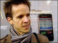 iPhone shopper queuing outside The Apple Store in London
