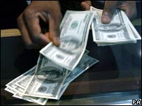Dollar bills being counted