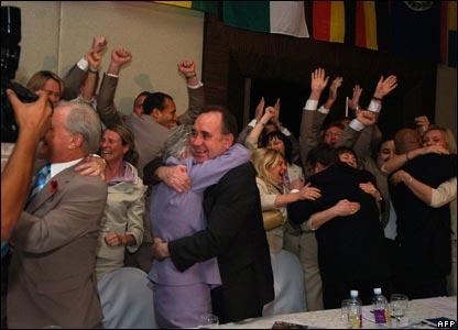 Alex Salmond hugs Glasgow bid team member Louise Martin after the decision in Sri Lanka.