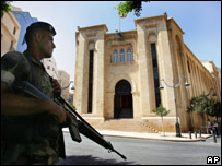 A Lebanese soldier stands in front of the Lebanese Parliament building in Beirut, Sept. 24, 2007