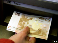 Euro notes being withdrawn from an ATM in France
