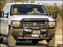 President Bush drives German Chancellor Angela Merkel after her arrival at his ranch in Crawford, Texas