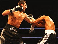 Carl Froch finds his way through Robin Reid's defence in Nottingham.