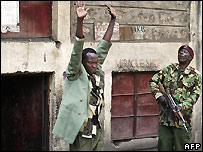 Police arrest a man during crackdown on Mungiki sect in Nairobi - 7/6/2007
