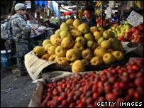 US soldier patrols Baghdad market (file pic)
