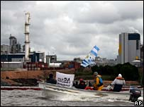 Protesters on boat in front of the pulp mill