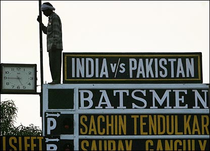 A groundsman gets the scoreboard ready for the third one-day international at Kanpur