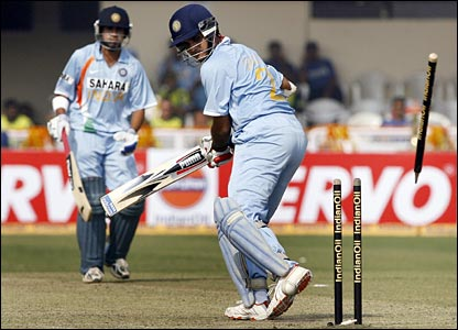 Ganguly looks on as his off-stump is dislodged by Tanvir