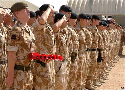 Soldiers paying their respects during the remembrance parade in Basra, Iraq