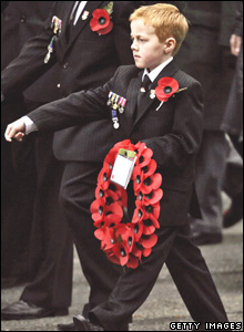 Young boy marching in Remembrance day parade