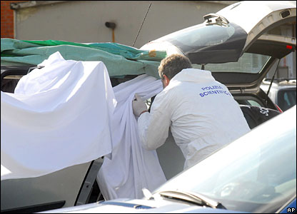 Forensic police examine the scene of the shooting