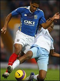 Portsmouth's Glen Johnson battles with Gelson Fernandes