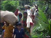 Family members of Communist party workers return to their village in Nandigram on 11 November 2007