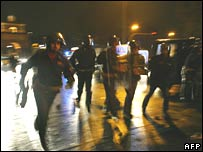 Italian policemen and football fans clash near Rome's Olympic Stadium on Sunday