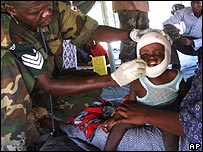 Wounded Somali child is treated by an African Union doctor at makeshift hospital , Mogadishu (8/11/2007)