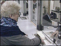 A pensioner at a post office counter