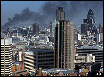 Smoke billowing across London including Gherkin