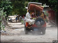 Somalis and their belongings in a car as they flee from their neighbourhood in Mogadishu
