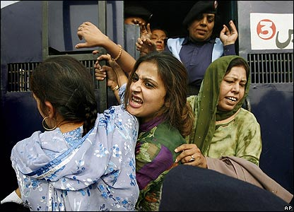 Police arrest a supporter of opposition leader Benazir Bhutto outside Ms Bhutto's residence in Lahore, Pakistan