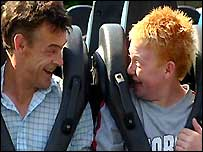Craig and his dad at a theme park