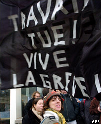 "Students attend a general assembly at the Rennes II University with a banner reading: ""Work kills, long live the strike!"""