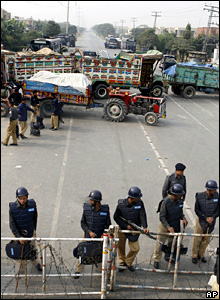 Police block a main roads near Benazir Bhutto's house in Lahore