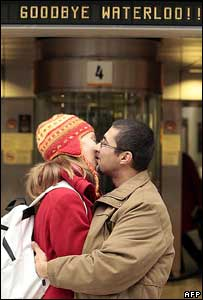A couple embrace at Waterloo station