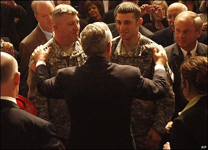 President Bush greeting two soldiers