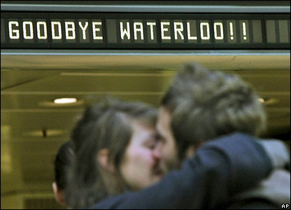 A couple kiss under a sign reading Goodbye Waterloo