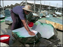 A worker washes jade ahead of the auction in Rangoon