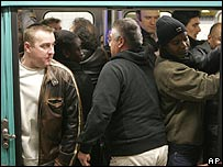 Commuters cram on to a metro train in Paris